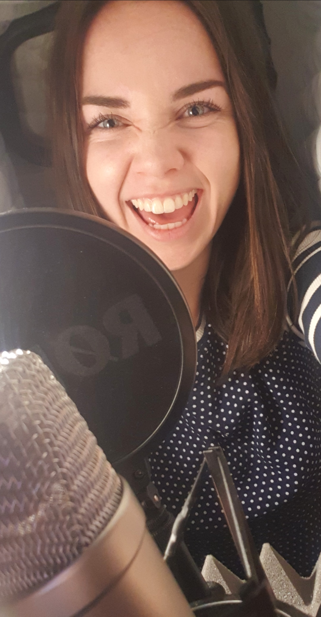Katherine takes a selfie in her voiceover booth